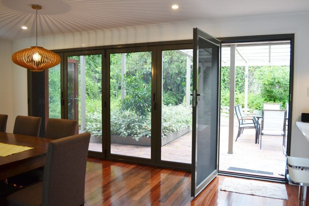 Crimsafe bifold door with one panel open