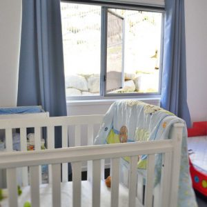 Crimsafe security window with safe-s-cape installed in children's bedroom