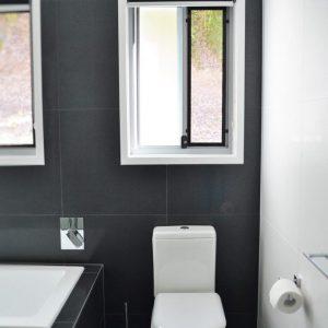 Crimsafe security screens installed in bathroom above toilet