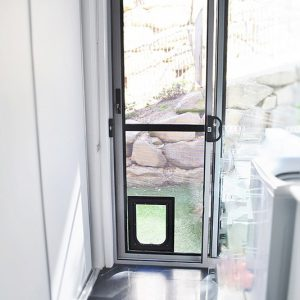 Crimsafe security door installed in laundry with pet door