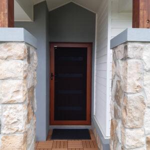 Crimsafe front door in red cedar