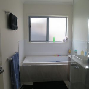 Crimsafe security screens installed on bathroom window above bathtub