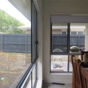 Crimsafe security screens installed on windows and doors leading to outdoor living area