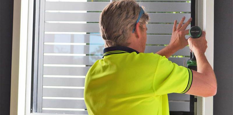 licensed crimsafe installer fitting crimsafe security screens