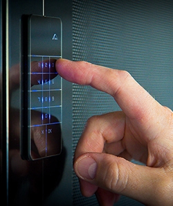man using a security touch screen to open crimsafe iQ doors